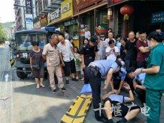 男子突发疾病晕倒街头 武当山辅警路过及时救援助脱险